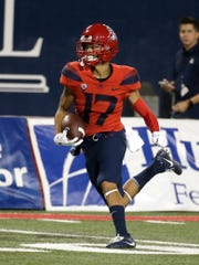 Arizona cornerback Jace Whittaker (17) intercepts a pass by UCLA quarterback Josh Rosen and scores a touchdown in the first half during an NCAA college football game, Saturday, Oct. 14, 2017, in Tucson, Ariz.