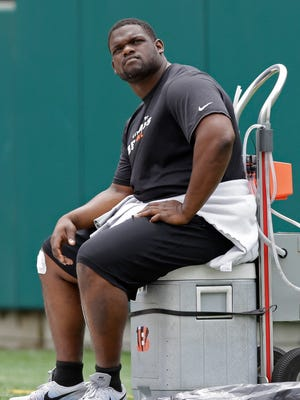 Marvin Lewis is planning on watching Geno Atkins for a few days before he decides whether he's ready to begin training camp.