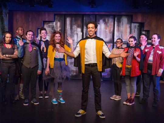 """James Fouhey (center) with the cast of """"Puffs."""""""