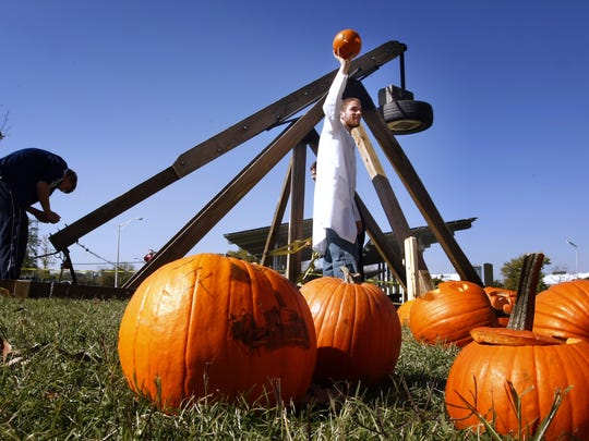 David Harris shows a Jack O' Lantern to the crowd before it is fired down range at the Adventure Science Center's Pumpkin ChunkinÕ event. They use a trebuchet to fire the pumpkins up to 200 ft.  November 1, 2008 (photo GEORGE WALKER IV / THE TENNESSEAN)