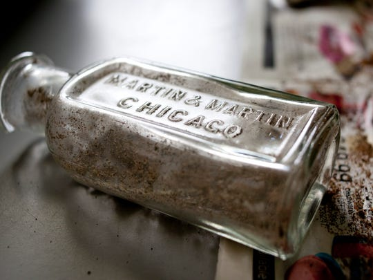 A bottle from the early 1900s, which contained shoe polish, is one of dozens of artifacts found at the Fort Gratiot Light Station County Park.
