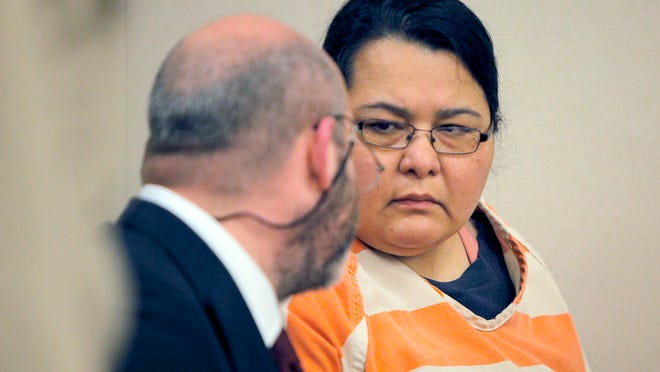 Cristian Jessica De Anda speaks with defense attorney Jeremy Dzubay during her arraignment in March 2014.