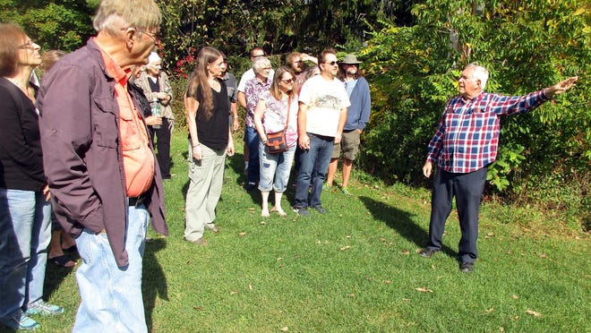 Art Zimmer, right, leads a tour last September to the site of the 1955 Great Chocolate Train Wreck in Hamilton. The Great Chocolate Wrecktoberfest returns Sept. 26-27 to Good Nature Farm Brewery in Hamilton for a fourth annual candy commemoration.