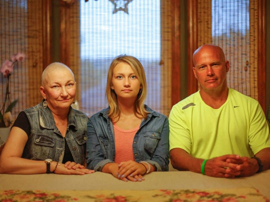 Abigail Strutzenberg, center (joined by parents Jann and Dan) was a victim of sexual misconduct by the son of the superintendent of Treynor High School over a span of time when she was a student there. The Strutzenberg family sued the school district and won a settlement.
