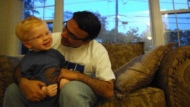 Amit Ringshia is seen with his son Nitai at their home in Maywood, NJ. Amit, a technical manager at KPMG, took paid paternity leave offered by his employer and took off Tuesdays to be with his son through a flexible work program.