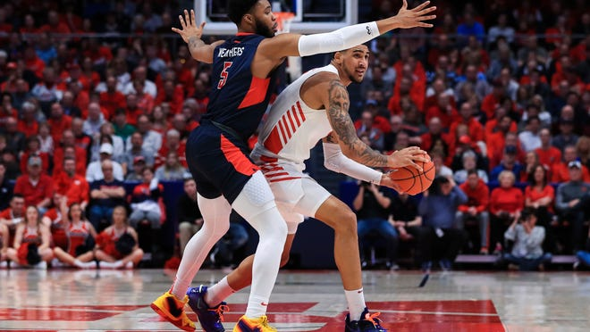 Duquesne's Marcus Weathers (5) defends against Dayton's Obi Toppin (1) in the first half of an NCAA college basketball game, Saturday, Feb. 22, 2020, in Dayton, Ohio. (AP Photo/Aaron Doster)