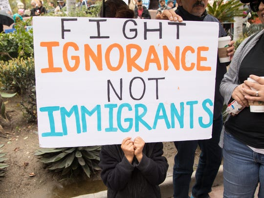 Opponents of President Trump protest his immigration policies in Los Angeles, Feb. 18, 2017.