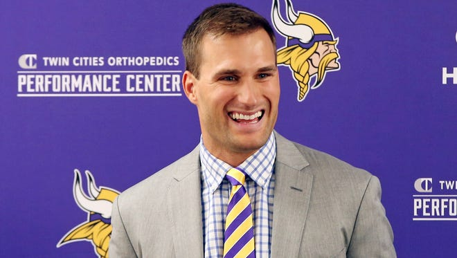 Minnesota Vikings new quarterback Kirk Cousins addresses the media after he was introduced during a news conference, after signing a three-year, $84 million contract March 15, 2018.