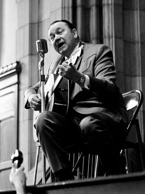 """Tex Ritter has the Vanderbilt University students in the palm of his hand as he closed out his performance with his acted-out version of """"Rye Whisky"""" during the Freshmen Forum at Neely Auditorium Feb. 15, 1968."""