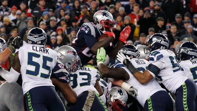 The Seattle Seahawks defense holds off New England Patriots running back LeGarrette Blount (29) in the last seconds of play at Gillette Stadium.