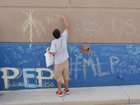 Chalk the Block offers visitors a chance to write on