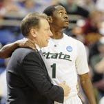 MSU's Kalin Lucas and head coach Tom Izzo hug in Minneapolis near the end of  the Spartan's 77-62 victory over Robert Morris in the NCAA tournament Friday March 20, 2009. (photo by Rod Sanford) Photo Gallery