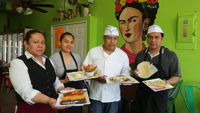 Veronica Tapia, Felicita Gasteran, Marco Alvarez and Claudio Alvarez hold some plates of Mexican food at their restaurant, Frida's Tacos, a Mexican restaurant on South Broadway in Yonkers, May 18, 2017.