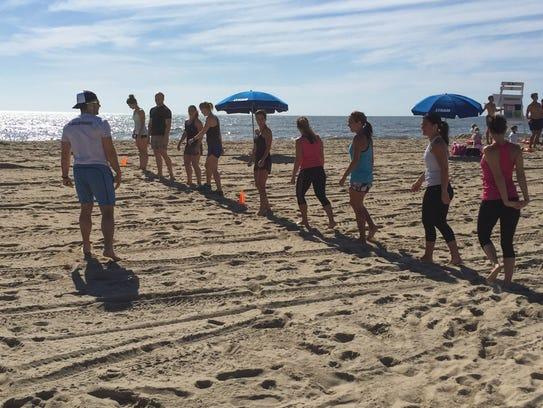 Blair Jost, owner of Dewey Beach Fit, instructs classes