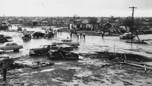 Lake View area residents survey the extensive damage done by the tornado of May 11, 1953.