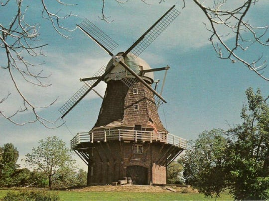A historic postcard of the iconic windmill next to