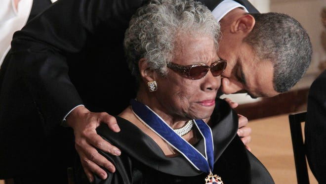 ORG XMIT: DCPM101 President Barack Obama kisses author and poet Maya Angelou after awarding her the 2010 Medal of Freedom during a ceremony in the East Room of the White House in Washington, Tuesday, Feb. 15, 2011. (AP Photo/Pablo Martinez Monsivais)