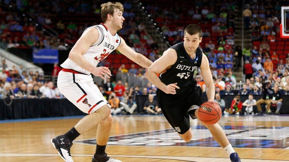Butler Bulldogs forward Andrew Chrabascz (45) dribbles the ball around Texas Tech Red Raiders forward Matthew Temple (34) during the first half at PNC Arena.