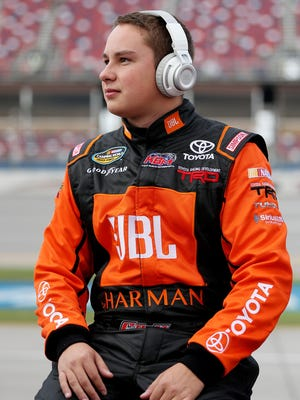 Christopher Bell relaxes on the grid during qualifying for the Camping World Truck Series race at Talladega Superspeedway last weekend.