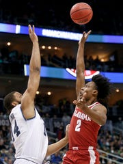 Alabama's Collin Sexton (2) floats a shot over Villanova's