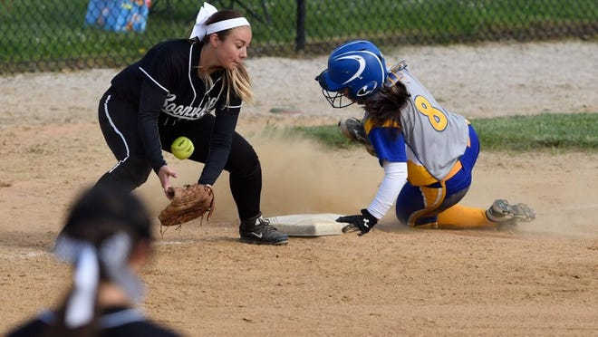 MIKE LAWRENCE / COURIER & PRESS Booneville's Sydney Cox can't get a handle on the ball as Castle's Aleyah Shaw steals third base during Saturday's Warrick County Showcase softball tournament in Boonville, May 14, 2016.