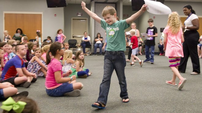 """Photos by DENNY SIMMONS / THE GLEANER Elijah Devine celebrates his being named to the cast of the Missoula Children's Theatre production """"Rapunzel"""" after tryouts at the Professional Development Center in Henderson Monday morning. The youngster will portray one of the mushrooms in the play."""