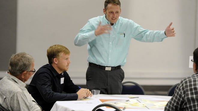 Wesley Smith talks with his group members during a 2016 brainstorming session at a public meeting to discuss the future of downtown Abilene at the Abilene Civic Center.
