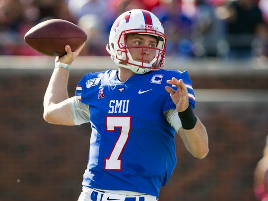 SMU quarterback Shane Buechele throws the ball during the second quarter of an NCAA college football game against Temple in Dallas, Saturday, Oct. 19, 2019. (AP Photo/Sam Hodde)