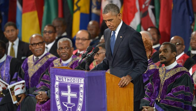 President Obama delivers the eulogy during the funeral of Clementa Pinckney at the College of Charleston TD Arena on June 26, 2015.