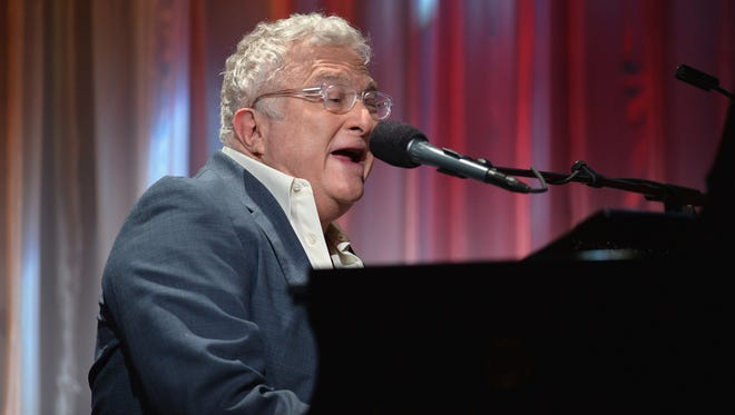 """Randy Newman, shown performing in Beverly Hills, Calif., in 2013, became one of pop-rock's premiere satirists (""""You Can Leave Your Hat On,"""" """"I Love L.A."""") before shifting gears and becoming an acclaimed film composer (the """"Toy Story"""" movies, """"The Natural"""")."""