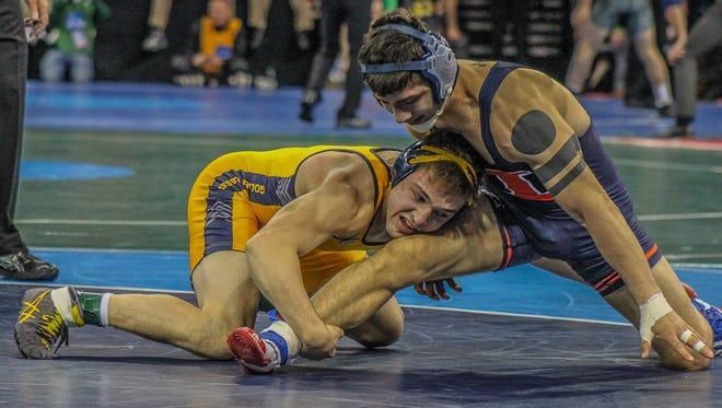 Kent State's Ian Miller, left, wrestles Illinois' Isaiah Martinez during the NCAA Championships on Friday.