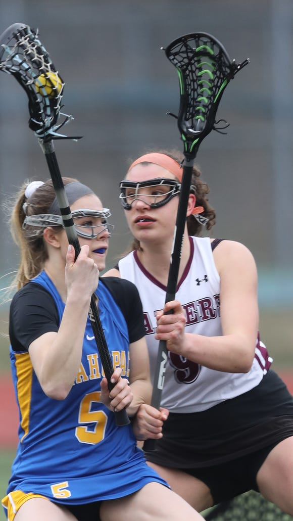Mahopac's Ally Conlin (5) keeps the ball away from