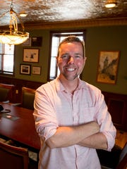 Chris Howard, owner of the historic Blodgett Haus located at 222 Central Ave. in Marshfield, smiles inside the conference room.