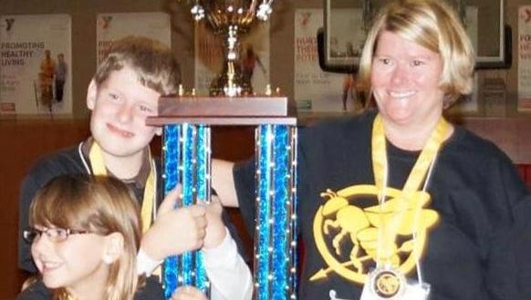 """2014 """"Victors"""" of """"SPELL for Great Futures"""" included, from left: Boys & Girls Club members and siblings Katie and Nathan Ziegler, along with Dr. Karen Meyer of Agnesian Healthcare."""