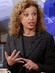 FILE- In this March 21, 2016 file photo. Democratic National Committee Chair, Rep Debbie Wasserman Schultz, D-Fla. is interviewed in New York. The email leaks that cost U.S. Rep. Debbie Wasserman Schultz her second job as chair of the Democratic National Committee are now threatening her bid for a seventh term from a South Florida district where, until recently, she was seen as unbeatable. Wasserman Schultz is facing a strong challenge in the Aug. 30 Democratic primary from law professor Tim Canova, a liberal who accuses the incumbent of being in the pocket of Wall Street and big banks. (AP Photo/Richard Drew, File)