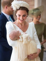Duchess Kate of Cambridge carries Prince Louis as they
