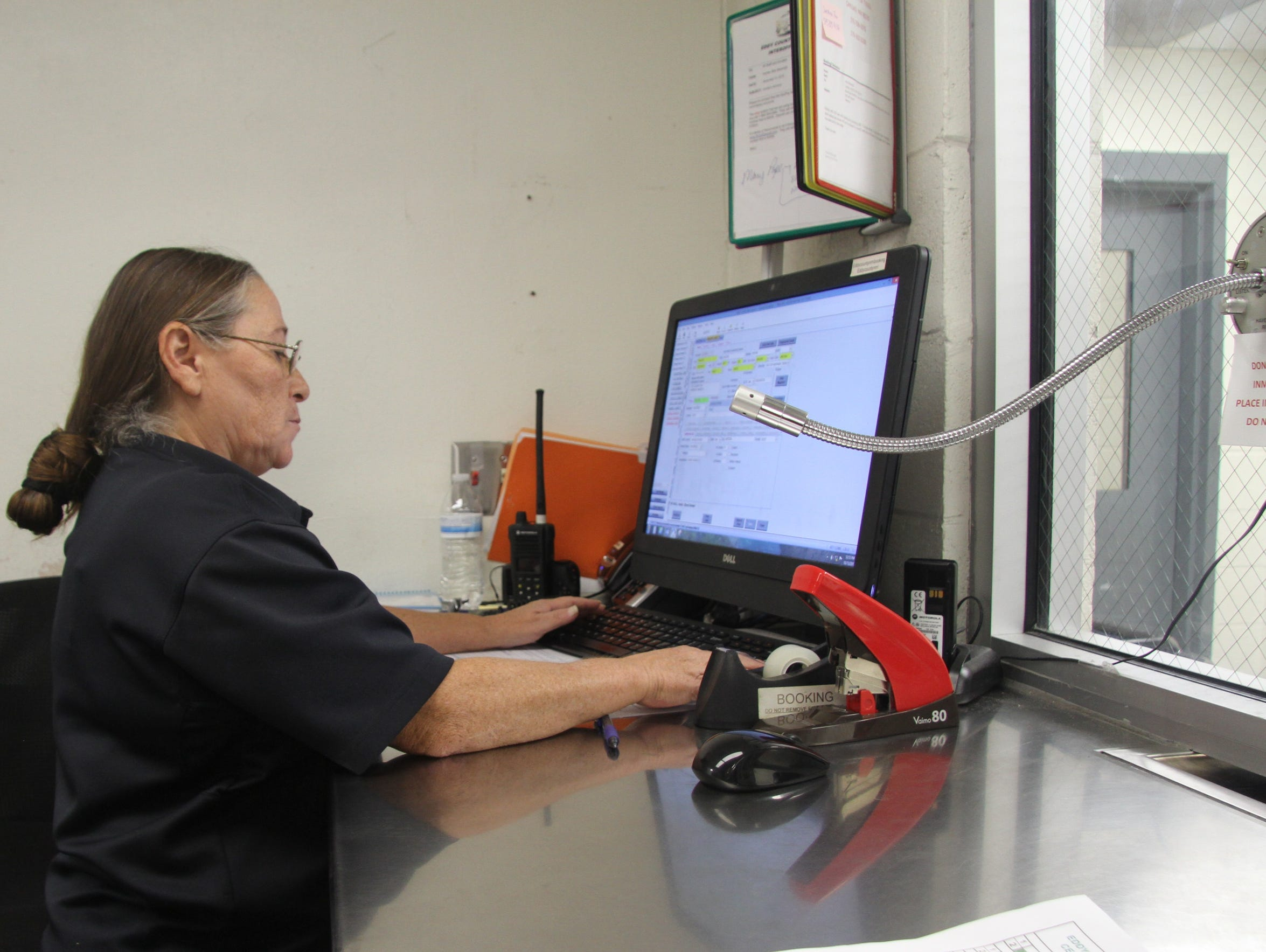 Booking clerk Maria Saiz completes a process which