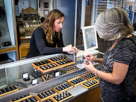 A customer looking for the perfect piece at Murray's Jewelers.