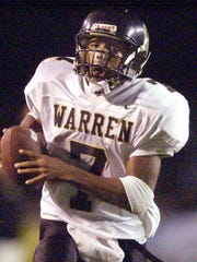 Warren Central's Desmond Tardy (#7) runs in for a 27-yard