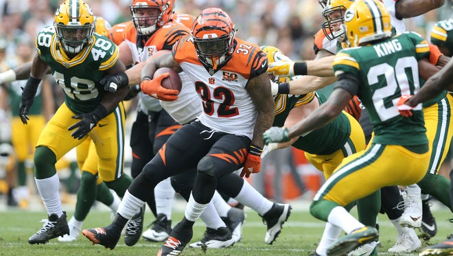 Cincinnati Bengals running back Jeremy Hill (32) finds running room in the second quarter during the Week 3 NFL football game between the Cincinnati Bengals and the Green Bay Packers, Sunday, Sept. 24, 2017, at Lambeau Field in Green Bay, Wisconsin.