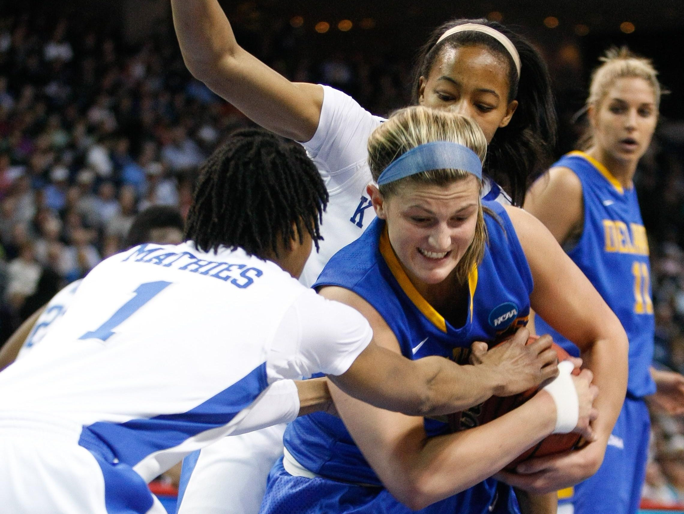 Delaware guard Lauren Carra snags the rebound. Delaware takes on Kentucky at Webster Bank Arena in the Regional semi-finals of the 2013 NCAA Division I Women's Basketball Championship in Bridgeport, Ct. Saturday March 30, 2013. SUCHAT PEDERSON/THE NEWS JOURNAL