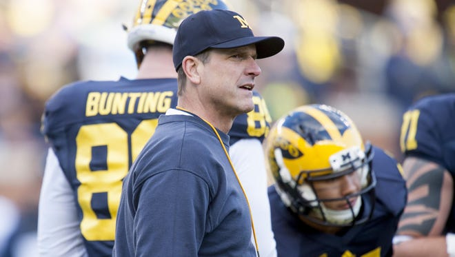 Jim Harbaugh and Michigan, doomed by a pair of late-season, last-second losses, will head to Miami with an Orange Bowl berth opposite Florida State (9-3) on Dec. 30.