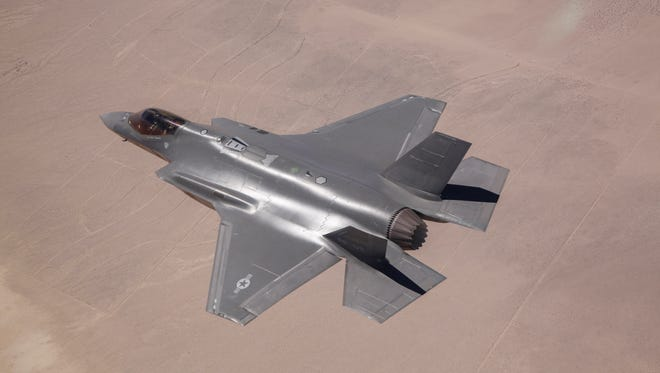 An F-35A model is shown flying during testing in 2014.