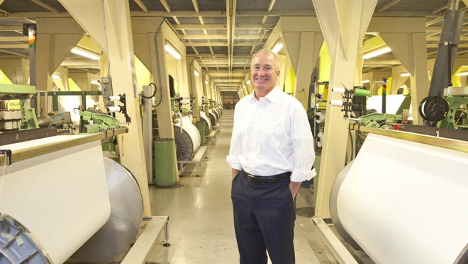Dirk Pieper, CEO of Greenville-based Sage Automotive Interiors, inside the company's textile weaving plant in Abbeville County.