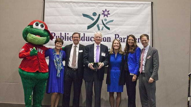 Pictured (left to right) Reedy Rip'It, PEP Executive Director Grier Mullins, PEP Board Chair Neil Grayson, Greenville Drive Owner/President Craig Brown, Say Yes to Education President Mary Anne Schmitt-Carey, PEP Board Member Leesa Owens, PEP Associate Director Ansel Sanders.