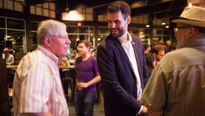 Zach Wahls is greeted by outgoing state Sen. Bob Dvorsky during Wahls' election night party at 30hop in Coralville on Tuesday, June 5, 2018. Wahls won the Democratic nomination for Senate District 37, currently held by Dvorsky.