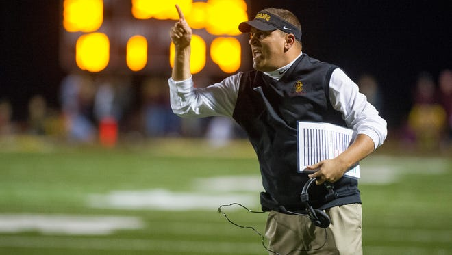 Gibson Southern's head coach Nick Hart yells down field during their game against Southridge at Jewell Memorial Field in Fort Branch, Friday, Oct. 14, 2016. Gibson Southern beat Southridge 38-35.
