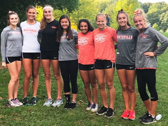 Northville's eight cross country seniors ran their