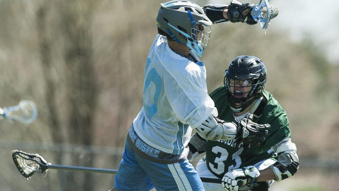 South Burlington's Calvin Hultgren (10) gets past Salmon River's Balze Benedict (33) with the ball during the high school boys lacrosse game between Salmon River, New York and South Burlington at South Burlington High School on Saturday afternoon.
