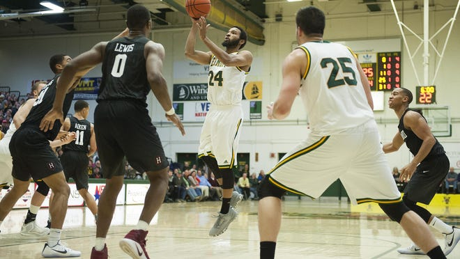Vermont's Dre Wills (24) leaps to take a shot during the men's basketball game between the Harvard Crimson and the Vermont Catamounts at Patrick Gym on Monday night.